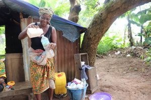 The Water Project:  Woman Selling Palm Wine