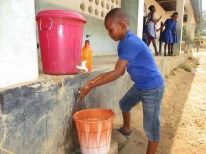 The Water Project:  Student Demostrating Hand Washing