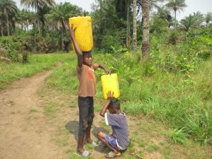 The Water Project:  Helping Mount Container On His Head