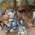 The Water Project: Lokomasama, Rotain Village -  Young Men Transporting Moud Blocks With Motorbkie