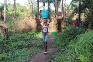 The Water Project:  Small Boy Carrying Water