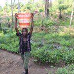 The Water Project: Lokomasama, Rotain Village -  Small Boy Carrying Water