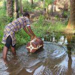 The Water Project: Lokomasama, Rotain Village -  Small Girl Collecting Water