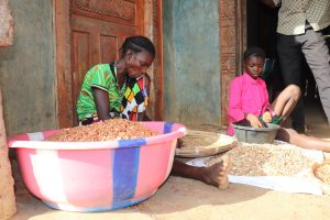 The Water Project:  Woman And Child Processing Ground Nut