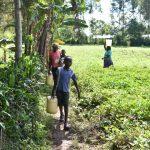 The Water Project: Emusaka Community, Muluinga Spring -  Taking Water Home From Muluinga Spring