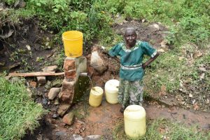 The Water Project:  Collecting Water From Wanzetse Spring