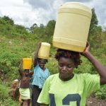 The Water Project: Bukalama Community, Wanzetse Spring -  Taking Water Home From Wanzetse Spring