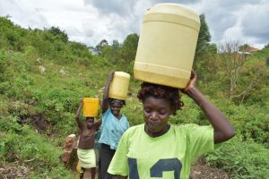 The Water Project:  Taking Water Home From Wanzetse Spring