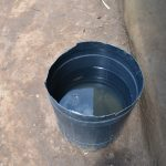 The Water Project: Bukalama Community, Wanzetse Spring -  Water Storage Container