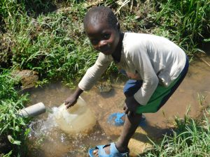 The Water Project:  Collecting Water From Ashuma Spring