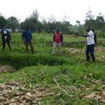 The Water Project: Eshiakhulo Community, Asman Sumba Spring -  Regional Director Humphrey Buradi Talks To Community Before Construction