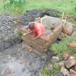 The Water Project: Eshiakhulo Community, Asman Sumba Spring -  Reservoir Tank Brickwork