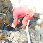 The Water Project: Ikonyero Community, Jesse Spring -  Installing Gate Valve For Drawing Water