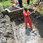 The Water Project: Eshiakhulo Community, Asman Sumba Spring -  Artisan Joseph Laying Drawing Area Foundation