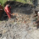 The Water Project: Eshiakhulo Community, Asman Sumba Spring -  Laying Wiremesh Over Rock Foundation