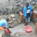 The Water Project: Eshiakhulo Community, Asman Sumba Spring -  Helping Hands Not In School Due To Covid