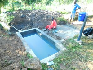 The Water Project:  Water Filled Reservoir Tank