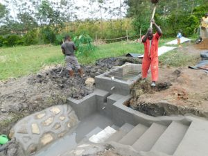 The Water Project:  Steel Bars Laid Over Reservoir Tank