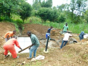 The Water Project:  Building Barriers For Slab Cement