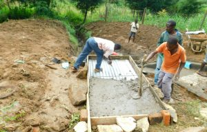 The Water Project:  Covering Top Slab