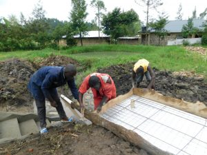 The Water Project:  Aligning Iron Sheet And Wiremesh Cover Before Pouring Concrete