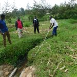 The Water Project: Eshiakhulo Community, Asman Sumba Spring -  Humphrey Shows Measurement Of Proposed New Drainage