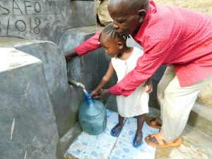 The Water Project:  Showing How To Turn On The Valve
