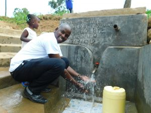 The Water Project:  Field Officer Jonathan Mutai Celebrates The New Reservoir Tank