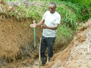 The Water Project:  Regional Director Humphrey Buradi Supervising Work