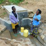 The Water Project: Ikonyero Community, Jesse Spring -  Fetching Water Is Easy Again