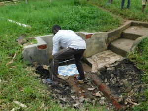The Water Project:  Removing The Stone Pitching For