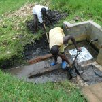 The Water Project: Eshiakhulo Community, Asman Sumba Spring -  Demolition Continues