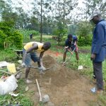 The Water Project: Eshiakhulo Community, Asman Sumba Spring -  Community Members Mixing Concrete
