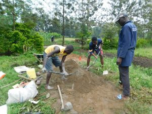 The Water Project:  Community Members Mixing Concrete