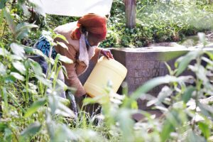 The Water Project:  Cleaning Her Container Before Fetching Water