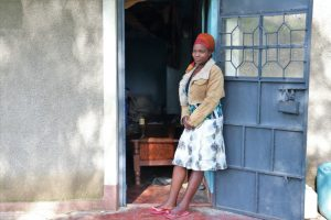 The Water Project:  Isabella In Front Of Her House