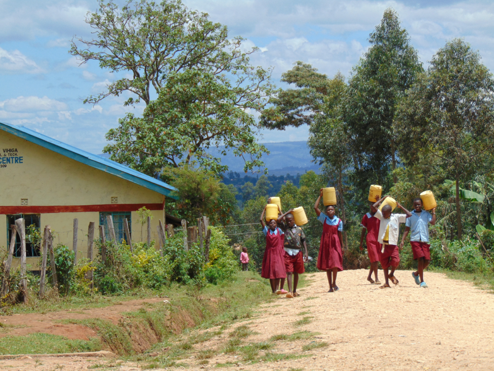 The Water Project : kenya20159-pupils-carrying-water-from-home