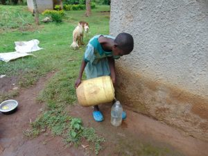 The Water Project:  Pupil Collecting Water At Home