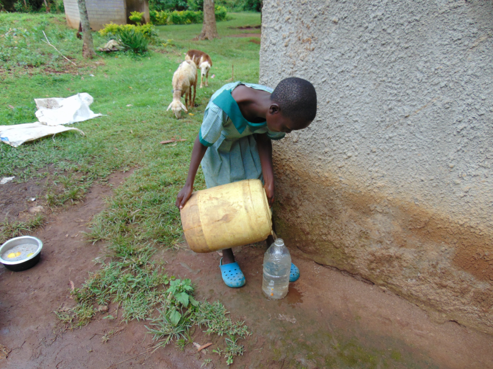 The Water Project : kenya20161-pupil-collecting-water-at-home-2