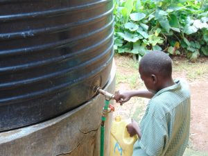 The Water Project:  Pupil Collecting Water For The School Cook