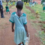 The Water Project: Friends Musiri Primary School -  Pupil Coming Back To School With Water