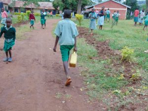 The Water Project:  Pupil Coming Back To School With Water