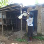 The Water Project: Mahira Community, Mukalama Spring -  Carolyne Refills Her Home Handwshing Station
