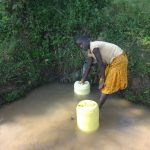 The Water Project: Mahira Community, Mukalama Spring -  Collecting Water