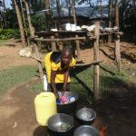 The Water Project: Mahira Community, Mukalama Spring -  Doing Dishes Next To Drying Rack