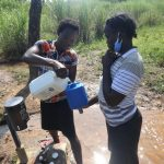 The Water Project: Mahira Community, Mukalama Spring -  Refilling Chlorine Dispenser