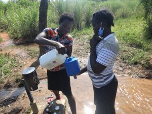 The Water Project:  Refilling Chlorine Dispenser