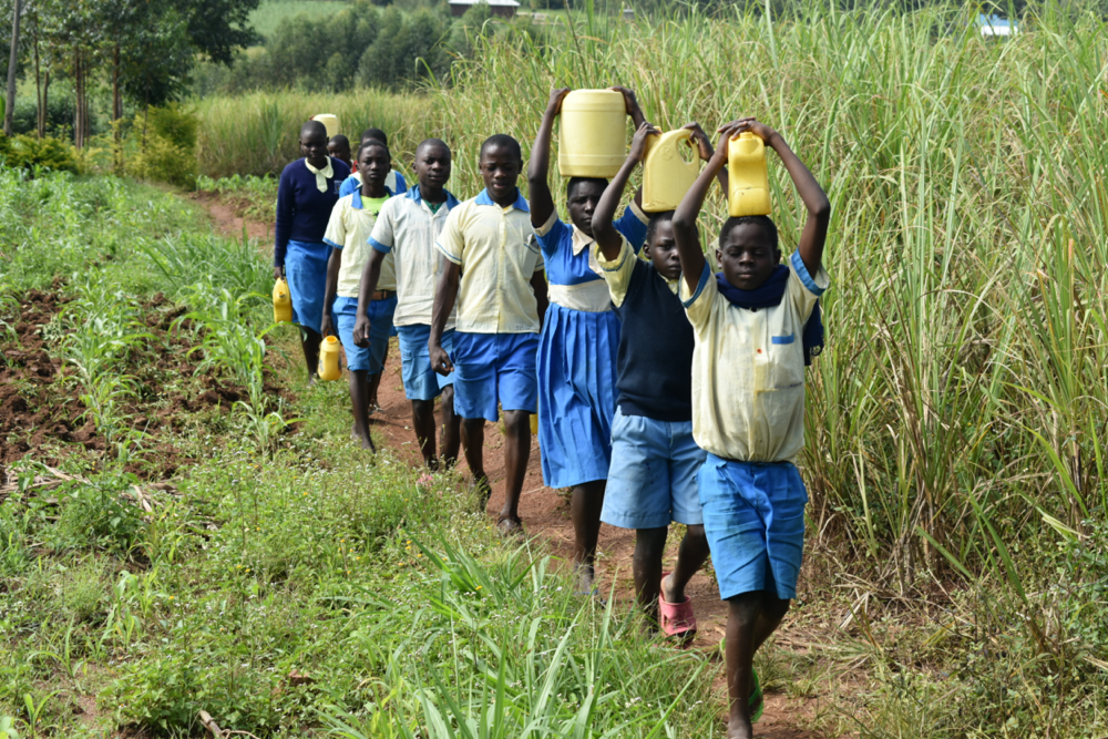 The Water Project : kenya20008-students-carrying-water-1