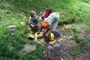 The Water Project:  Collecting Water From Olindo Spring