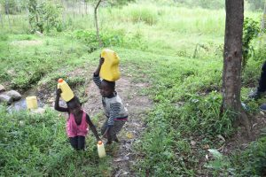 The Water Project:  Taking Water Home From Olingo Spring